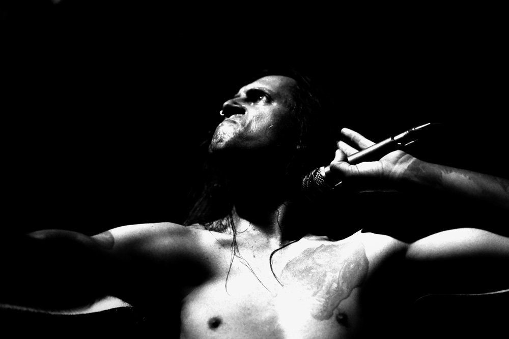 Man holding a microphone performing with passion