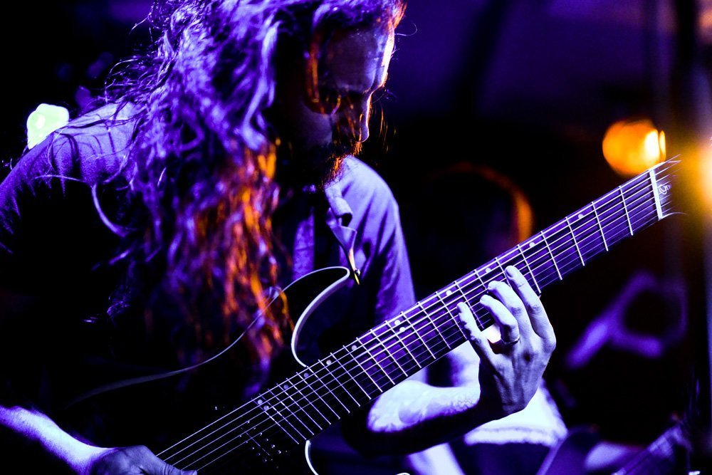 Electric Guitarist in Purple Light